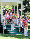 A Kazoo band performs for a crowd on a Town Common bandstand
