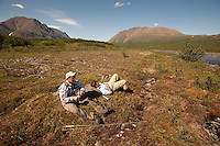 150620-JRE-7981E-0492 Joshua Quong, left, and Cal Trout, right, both teachers and quail hunting guides from Mississippi, rest on the tundra after hiking into a remote interior Alaska stream to fly fish for Arctic Grayling.
