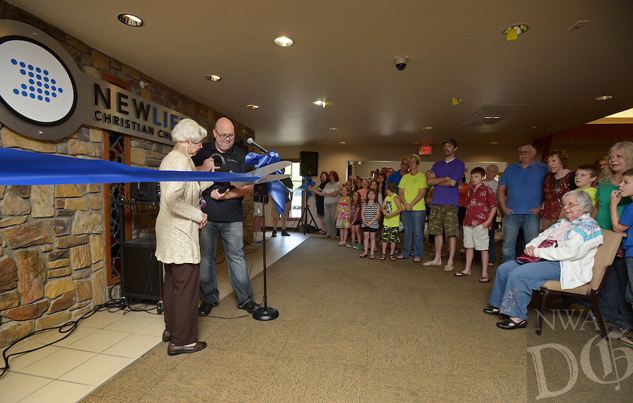 NWA Democrat-Gazette/BEN GOFF @NWABENGOFF<br /> Joe Williams, lead pastor, and Jackie Carter, a charter member of the congregation, cut the ribbon on Saturday June 4, 2016 during a ribbon-cutting and 'big reveal' for the newly renovated auditorium at New Life Christian Church in Bella Vista. The church was opened in 1974 as Bella Vista Christian Church and has undergone several expansions over the years. The church rebranded itself New Life Christian at the beginning of the year and began the renovation project for the auditorium on March 28.