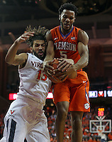 Virginia forward Anthony Gill (13) and Clemson forward Jaron Blossomgame (5) fight for a rebound during an ACC basketball game Tuesday Jan. 19, 2016, in Charlottesville, Va. Virginia  defeated Clemson  69-62. (Photo/Andrew Shurtleff)