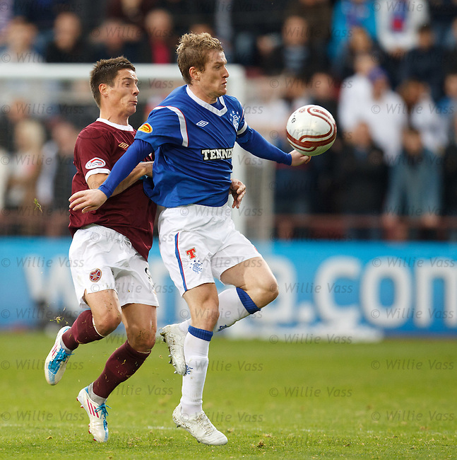 Steven Davis holds off Ian Black