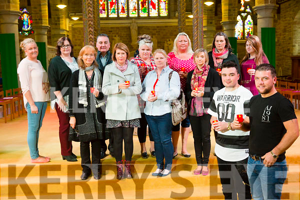 Prayer service by Kerry Travellers Health and Community Development Project for victims of Carrickmines fire tragedy at St. John's Church on Thursday Pictured Front l-r  Martin Mahon and Mikey McCarthy. Middle l-r Mary Kiernan, Kerry Deveron, Noreen Casey and Helena Clarke Back l-r  Bridget McCarthy, Siobhan O'Connor, Fr Francis Nolan, Michelle McCarthy, Anita Qulligan, Aideen Moynihan and Tammy O'Brien.