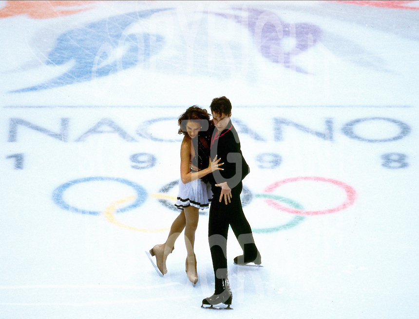 Chantal Lefebvre and Michel Brunet of Canada compete at the 1998 Olympics in Nagano, Japan. Photo copyright Scott Grant.