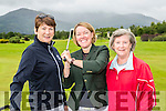 Beaufort Captain Lisa Kerfoot centre practises her swing at the Captain's Competition on Saturday with left Eileen kelliher and Mona Looney