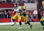 Green Bay Packers defensive back Pat Lee (22) tackles Pittsburgh Steelers running back Mewelde Moore (21) during Super Bowl XLV on Sunday, February 6, 2011, in Arlington, Texas. The Packers won 31-25. (AP Photo/David Stluka)