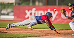 29 June 2014:  Lowell Spinners outfielder Franklin Guzman dives safely back to first against the Vermont Lake Monsters at Centennial Field in Burlington, Vermont. The Spinners defeated the Lake Monsters 7-5 in NY Penn League action. Mandatory Credit: Ed Wolfstein Photo *** RAW Image File Available ****