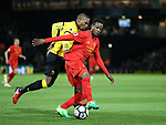 Watford's Chistian Kabasele tussles with Liverpool's Divock Origi during the Premier League match at Vicarage Road Stadium, London. Picture date: May 1st, 2017. Pic credit should read: David Klein/Sportimage
