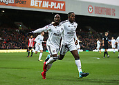 2nd December 2017, Griffen Park, Brentford, London; EFL Championship football, Brentford versus Fulham; Neeskens Kebano of Fulham celebrates scoring his sides 1st goal in the 25th minute to make it 1-0 with Ryan Sessegnon of Fulham