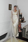 Carla poses in a cream gold panel back bridal gown and Monvieve veil during the Barbara Tfank Fall Winter 2019 collection on February 13, 2019 at The Elizabeth Collective during New York Fashion Week.