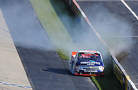 May 30, 2008; Dover, DE, USA; Nascar Craftsman Truck Series driver Brian Scott crashes during the AAA Insurance 200 at Dover International Speedway. Mandatory Credit: Mark J. Rebilas-US PRESSWIRE.