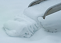 Snow gathers in a ribbon at the bottom of a metal slide after an overnight storm in Columbus, Ohio.<br />