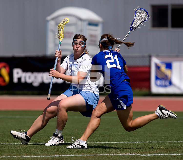 Corey Donohoe (7) of North Carolina tries to get past Sara Giedgowd (21) of Duke during the ACC women's lacrosse tournament semifinals in College Park, MD.  North Carolina defeated Duke, 14-4.