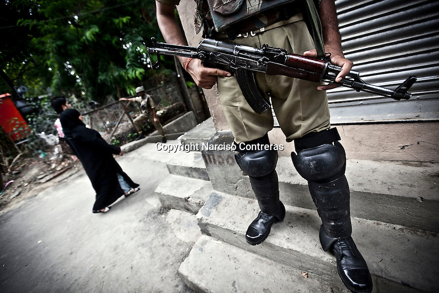 Indian paramilitary soldier patrolling the streets of Srinagar. Security along the Kashmir valley was beefed up like a preventive measure days before India's independence day.