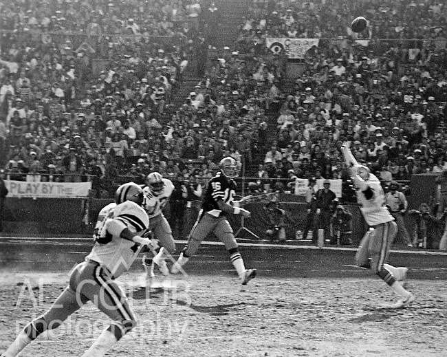 San Francisco 49ers vs.Dallas Cowboys at Candlestick Park Sunday, January 10. 1982..49ers beat Cowboys 28-27 for Conference Championship..San Francisco 49ers Quarterback Joe Montana (16) fire long pass down field...Photo By Al Golub/Golub Photography.