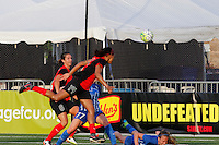Rochester, NY - Friday May 27, 2016: Western New York Flash forward Jessica McDonald (14) heads the ball as  Western New York Flash defender Abby Erceg (6) looks on. The Western New York Flash defeated the Boston Breakers 4-0 during a regular season National Women's Soccer League (NWSL) match at Rochester Rhinos Stadium.