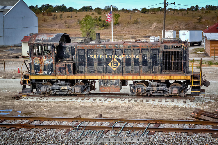 An Erie Lackawanna Alco S1 switcher Locomotive #315 sits outside of Galena Kansas on the old route 66.
