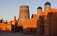 General view of the Kukhana Ark Fortress, with the Kalta Minar in the background and Matniyaz Divanbegi Madrasah in the distance, Khiva, Uzbekistan, pictured on July 6 2010 at sunrise.