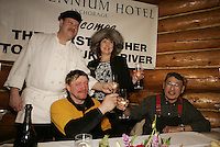 Chef Stephan England and Brooke McGrath of the Millenium hotel toast Paul Gebhart for being the first to the Yukon after Paul enjoyed his 7-course meal   Paul's dining guest is 1975 Iditarod champion Emmitt Peters of Ruby.