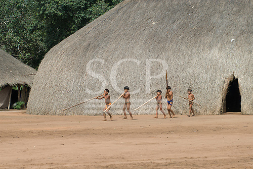 Xingu Indigenous Park, Mato Grosso State, Brazil. Aldeia Matipu (Matipu). Taquara Festival; group of boys joining in, learning to play the Taquara flutes and dance.