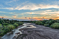 This wonderful sunset over Sandy Creek witht the water flowing and the colors in the sky made for a great image.  Sandy Creek is usually a dry sandy creeek but this spring we had a little water flowing through we thought it made for a beautifull image.