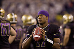 Washington Huskies quarterback Keith Price warms up along the sidelines in t he fourth quarter against the Oregon State Beavers at CenturyLink Field in Seattle, Washington on October 27, 2012.  Price completed 18 of 30 passes and had one intercepted in the Huskies upset 20-17 win over the 7th ranked Beavers.  ©2012. Jim Bryant Photo. ALL RIGHTS RESERVED.