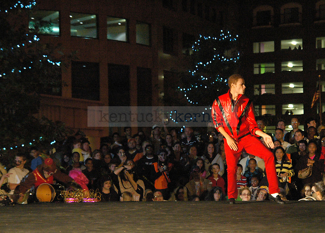 Business freshman Alex Sanders acts as Michael Jackson during the Thriller Parade in downtown Lexington Friday night. .Photo by Jon Reynolds | Staff