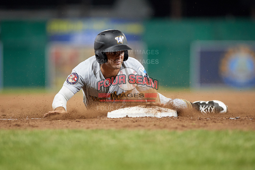 West Virginia Black Bears center fielder Daniel Amaral (27) slides into third base during a game against the Batavia Muckdogs on June 18, 2018 at Dwyer Stadium in Batavia, New York.  Batavia defeated West Virginia 9-6.  (Mike Janes/Four Seam Images)