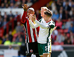 Jack O'Connell of Sheffield Utd and Angus MacDonald of Barnsley clash during the Championship League match at Bramall Lane Stadium, Sheffield. Picture date 19th August 2017. Picture credit should read: Simon Bellis/Sportimage