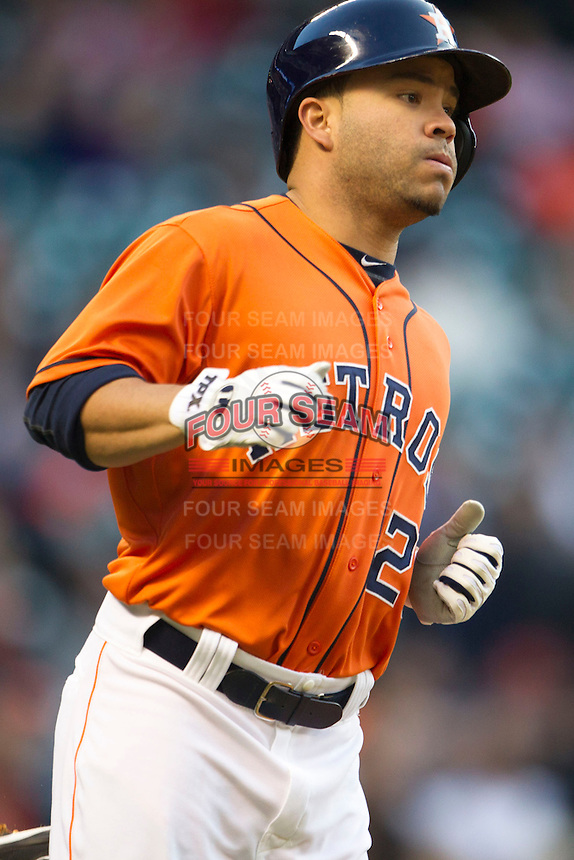 Houston Astros second baseman Jose Altuve (27) runs to first base during the MLB baseball game against the Detroit Tigers on May 3, 2013 at Minute Maid Park in Houston, Texas. Detroit defeated Houston 4-3. (Andrew Woolley/Four Seam Images).
