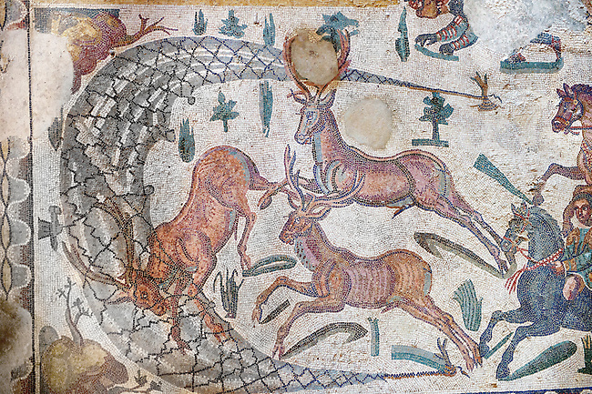 Hunter driving deer into a net from the Room of The Small Hunt, no 25 - Roman mosaics at the Villa Romana del Casale which containis the richest, largest and most complex collection of Roman mosaics in the world, circa the first quarter of the 4th century AD. Sicily, Italy. A UNESCO World Heritage Site.