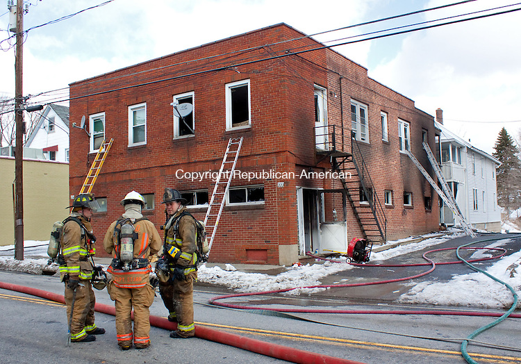 TORRINGTON CT-MARCH  20 132013 -0320DA01- Residents of a North Elm Street apartment building in Torrington are without a home following a fire Wednesday morning. No one was injured in the three-alarm fire at 222 N. Elm St., that was reported at 9:43 a.m..Darlene Douty Republican American