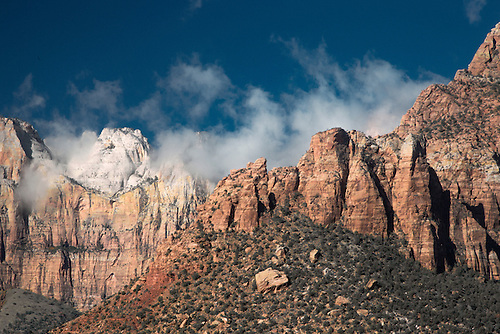 The morning sun shines on The Towers Of The Virgin at Zion National Park, Utah