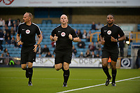 The officials Mr Simon Hooper Mr Akil Howson Mr Ian Cooper warm up  during Millwall vs Stevenage, Caraboa Cup Football at The Den on 8th August 2017