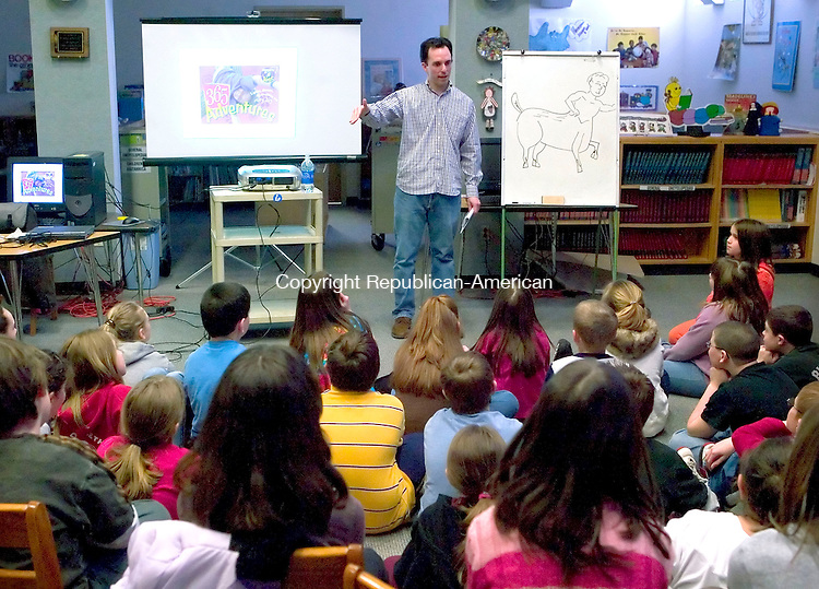 BETHLEHEM, CT--20 MARCH 2007--032007JS01-Author and cartoonist Marc Tyler Nobleman speaks to fifth graders at Bethlehem Elementary School in Bethlehem on Tuesday. Nobleman, an author of more than 0 books, shows the students sketches, a slide show and gave advice on how young writers and artists could get published. <br /> Jim Shannon / Republican-American