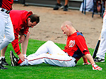 1 March 2011: Washington Nationals' outfielder Corey Brown shows signs of pain as he is checked out by trainer Lee Kuntz after a slide home during a Spring Training game against the New York Mets at Space Coast Stadium in Viera, Florida. The Nationals defeated the Mets 5-3 in Grapefruit League action. Mandatory Credit: Ed Wolfstein Photo