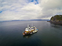 Aerial photo of the Nautilus Swell and Inde at anchor in the islands of Haida Gwaii, British Columbia, Canada.