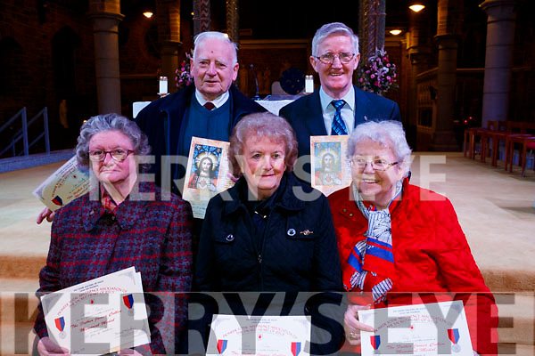 Carmel O'Connor (60 years), Con McCarthy (over 60 years) Bernie Rohan (65 years), Michael Moran (60 years) and Patsy Quirke (65 years), who were presented with their pioneer pins at St. John's Church Tralee on Saturday night last.