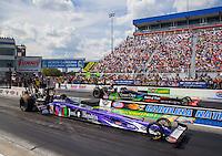 Sep 20, 2015; Concord, NC, USA; NHRA top fuel driver J.R. Todd (near) races alongside Clay Millican during the Carolina Nationals at zMax Dragway. Mandatory Credit: Mark J. Rebilas-USA TODAY Sports