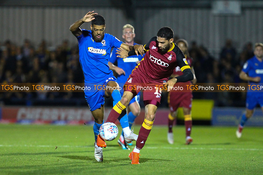 Jake Jervis of AFC Wimbledon and Kelvin Mellor of Bradford City during AFC Wimbledon vs Bradford City, Sky Bet EFL League 1 Football at the Cherry Red Records Stadium on 2nd October 2018