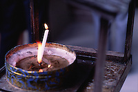 Close up of candles and incense at the Golden Temple. Kyoto, Japan.