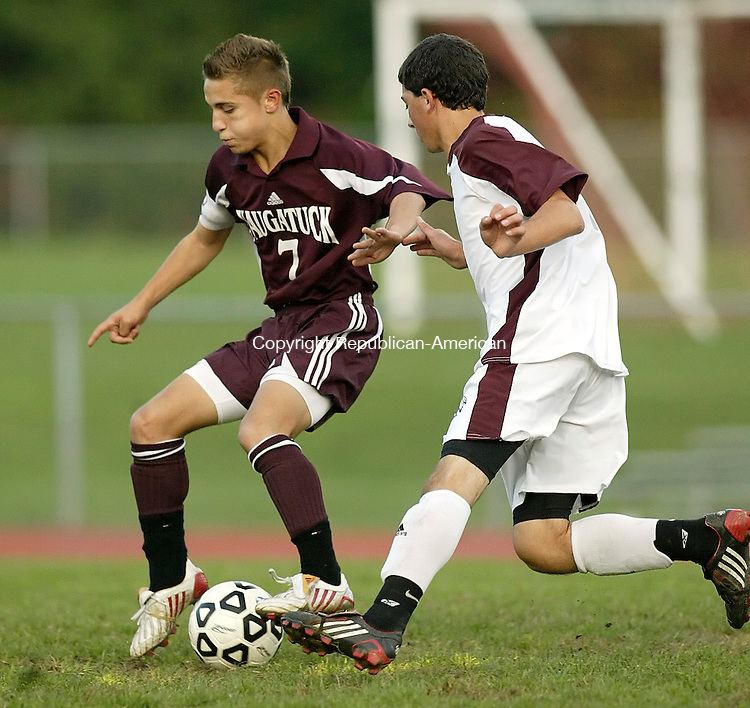 TORRINGTON, CT, 10/01/08- 100108BZ10- Naugatuck's Matt Carreira (7) under pressure from Torrington's Brett Longobucco (17) during their game at Torrington High Wednesday night.<br /> Jamison C. Bazinet Republican-American