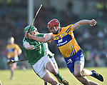 Seamus Hickey of  Clare  in action against Peter Duggan of  Limerick during their NHL quarter final at the Gaelic Grounds. Photograph by John Kelly.