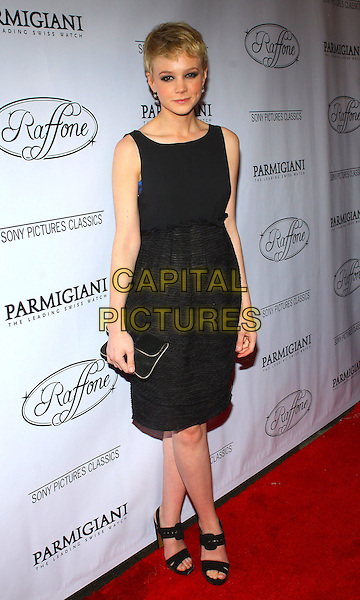 CAREY MULLIGAN.Parmigiani Watches & Raffone Luggage Sony Pictures Classics Oscar Party  held at II Cielo Restaurant, Beverly Hills, California, USA..March 6th, 2010.full length black dress clutch bag sleeveless .CAP/ADM/TC.©T. Conrad/AdMedia/Capital Pictures.