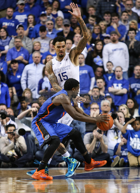 Kentucky forward Willie Caulie-Stein defends against Florida during the second half of the Kentucky vs. Florida game at Rupp Arena in Lexington, Ky.,on Saturday, March 7, 2015. UK defeated Florida 67-50, completing a perfect regular season. Photo by Adam Pennavaria | Staff