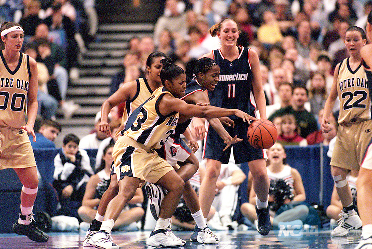 30 MAR 2001:  Guard Niele Ivey (33) of Notre Dame battles forward Swin Cash (32) of the University of Connecticut for a loose ball during the Division 1 Women's Basketball Semifinals held at the Savvis Center in St. Louis, MO.  Notre Dame defeated UCONN 90-75 to advance to the national championship game.  Jamie Schwaberow/NCAA Photos