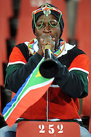 A Kenyan fan in maasai headgear shows his support for South Africa as he blows on a plastic horn. Iraq and New Zealand tied 0-0 during the FIFA Confederations Cup at Ellis Park Stadium in Johannesburg, South Africa on June 20, 2009..