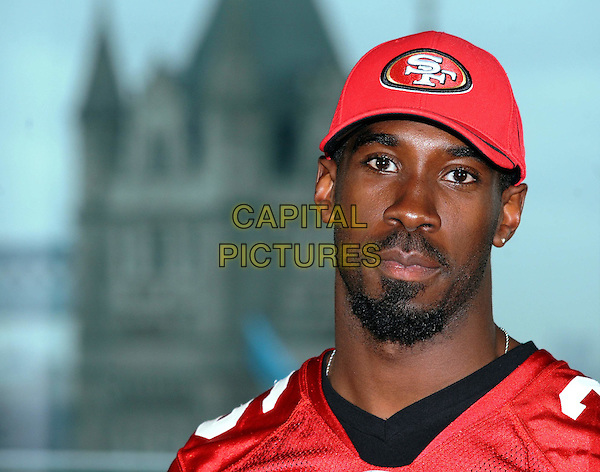 SHAWNTEE SPENCER.Mayor of London Boris Johnson meets the San Francisco 49ers cheerleaders, London, England, UK,.October 26th 2010..portrait headshot red cap hat beard facial hair player american footballer photocall.CAP/WIZ.© Wizard/Capital Pictures.