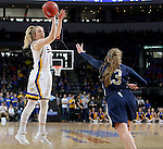 SIOUX FALLS, SD: MARCH 5: Madison Guebert #11 from South Dakota State University shoots a jumper over Ashley Beatty #23 from Oral Roberts during the Summit League Basketball Championship on March 5, 2017 at the Denny Sanford Premier Center in Sioux Falls, SD. (Photo by Dave Eggen/Inertia)