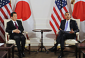 United States President Barack Obama , right, holds a bilateral meeting with Prime Minister of Japan Naoto Kan, left, in New York, New York, USA, Thursday, 23 September 2010.  The meeting between President Obama and Prime Minister Kan takes place on the sidelines of the 65th session of UN General Assembly (UNGA).     .Credit: Michael Reynolds - Pool via CNP.Credit: Michael Reynolds - Pool via CNP