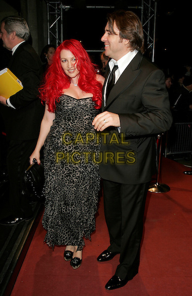 JANE GOLDMAN & JONATHAN ROSS.The Orange British Academy Film Awards (BAFTA's) aftershow, The Grosvenor House Hotel, London, UK..February 11th, 2007.full length dyed red hair leopard print dress black shoes married husband wife couple suit grey gray profile.CAP/AH.©Adam Houghton/Capital Pictures